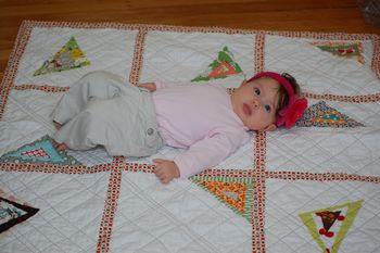 Amylouwho's baby on the triangle quilt