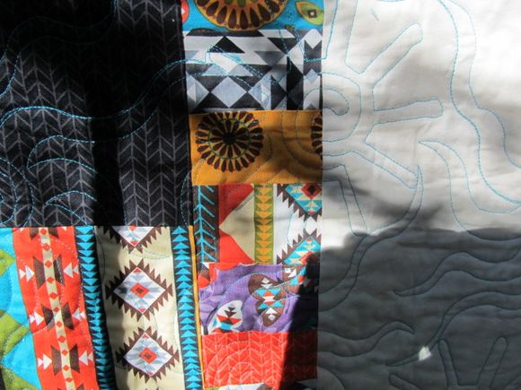 Native Soleil quilt back quilted w sun motif